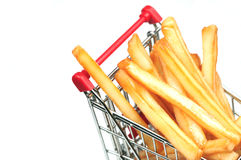Shopping for unhealthy goods. A shopping cart filled with french fries Royalty Free Stock Photo