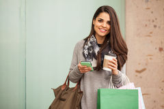 Shopping and updating her social media status Stock Photo
