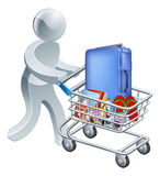 Shopping for a vacation concept. A person pushing a shopping cart trolley full of tropical holiday vacation items Stock Image