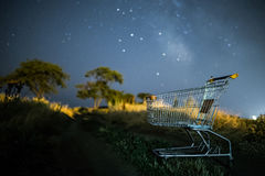 Shopping wagon cart under Milky Way stars Stock Images