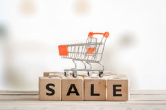 Shopping wagon on a sale sign Royalty Free Stock Photos