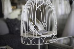 Shopping for wedding shoes in a cage stock photography