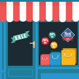 Shopping window with sale sign and bags. Flat design vector Royalty Free Stock Photo