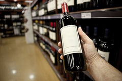 Shopping for wine Royalty Free Stock Photo