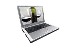 Shopping for wine online. Laptop isolated on white with picture of wine glasses and bottle on screen Royalty Free Stock Images
