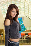 Shopping woman. Woman holding some shopping bags and smiling Stock Photos
