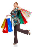 Shopping woman. Shopping happy woman. Isolated over white background royalty free stock photos