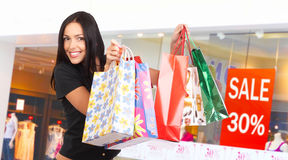 Shopping woman. Happy shopping  woman at the mall Stock Images