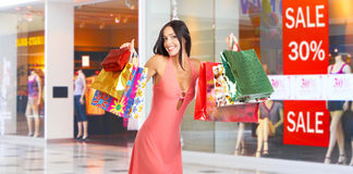 Shopping woman. Happy shopping  woman at the mall Stock Photography