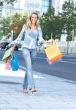 Shopping  woman. Happy shopping  woman walking on the street Stock Photography