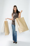 Shopping woman. Attractive smiling shopping woman with bags on her hands Royalty Free Stock Photo
