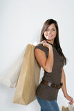 Shopping woman. Attractive smiling shopping woman with bags on her hands Stock Images
