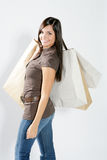 Shopping woman. Attractive smiling shopping woman with bags on her hand Stock Images