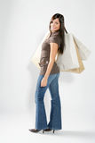 Shopping woman. Attractive smiling shopping woman with bags on her hand Royalty Free Stock Images