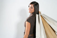 Shopping woman. Attractive smiling shopping woman with bags on her hand Royalty Free Stock Image