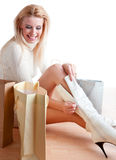 Shopping woman. Sitting on the floor Stock Images