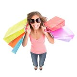 Shopping woman. Excited and happy. Dynamic and funny image of very hot young woman with shopping bags jumping in full length. Isolated on white background Royalty Free Stock Photo