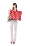 Shopping woman. Young cute woman standing and holding shopping bags Stock Photos