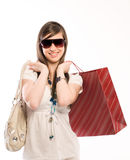 Shopping woman. Young cute woman holding shopping bags Royalty Free Stock Image