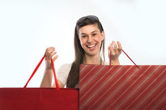 Shopping woman. Young cute woman holding several shopping bags Royalty Free Stock Image