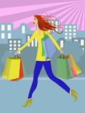 Shopping woman. Woman hurrying walking through town with shopping bags Stock Images