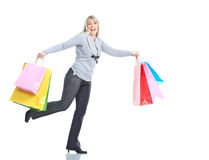 Shopping woman. Shopping happy running woman. Isolated over white background royalty free stock photos