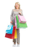 Shopping  woman. Shopping happy  elderly woman. Isolated over white background Royalty Free Stock Images
