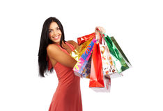 Shopping woman. Smiling shopping woman with bags. Isolated over white background Stock Photo