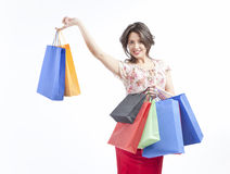 Shopping woman. Woman with shopping bags on white background smiling royalty free stock photography