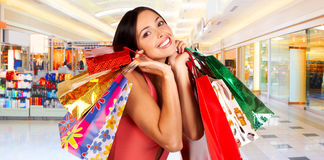 Shopping woman. Shopping smile woman in the mall Royalty Free Stock Photos