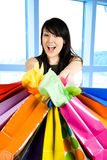 Shopping woman. A shot of a beautiful woman carrying shopping bags in a store stock image