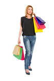 Shopping woman acting carrying gifts Royalty Free Stock Images