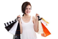 Shopping woman asian happy smiling holding shopping bags isolated on white background Stock Photo
