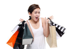 Shopping woman asian happy smiling holding shopping bags isolated on white background Royalty Free Stock Images