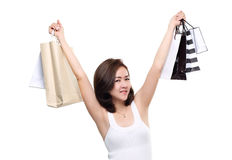 Shopping woman asian happy smiling holding shopping bags isolated on white background Stock Photos