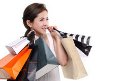 Shopping woman asian happy smiling holding shopping bags isolated on white background Royalty Free Stock Photos