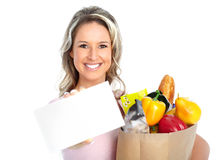 Shopping woman with a bag of food Royalty Free Stock Photography