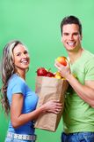 Shopping woman with a bag of food stock photos