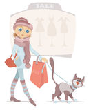 Shopping woman with bag and smiling cat on sale Stock Photo