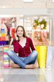 Shopping woman with bags talking on the phone Royalty Free Stock Photos