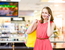 Shopping woman with bags talking on the phone Stock Photography