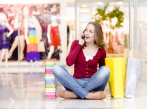 Shopping woman with bags talking on the phone. loo Stock Images