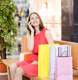 Shopping woman with bags talking on the phone Royalty Free Stock Image