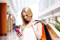 Shopping woman talking on the phone royalty free stock photography