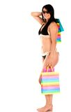 Shopping woman in bikini Royalty Free Stock Photos