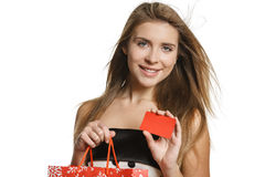 Shopping woman with blank credit card Royalty Free Stock Images