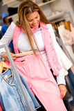 Woman buying clothes Stock Images