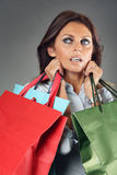Shopping woman carrying bags Stock Images