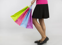 Shopping woman carrying paper shopping bags Stock Image