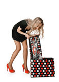 Shopping woman checks bag Royalty Free Stock Image